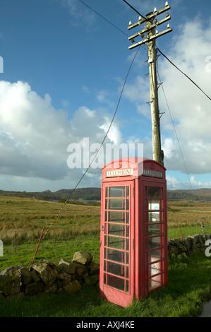 Red telephone box on the Isle of Mull, West Coast of Scotland, United Kingdom - Stock Photo