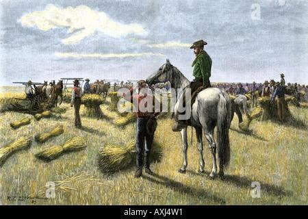 Harvesting wheat on a bonanza farm in Dakota Territory 1880s. Hand-colored woodcut - Stock Photo