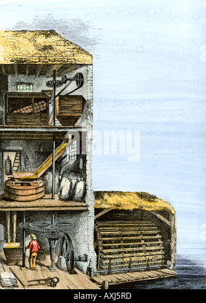 Cutaway view of a water powered mill for grinding grain into flour. Hand-colored woodcut - Stock Photo