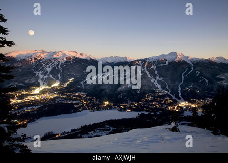 Whistler Village at dusk with alpine glow Blackcomb and Whislter mountain beyond British Columbia Canada - Stock Photo