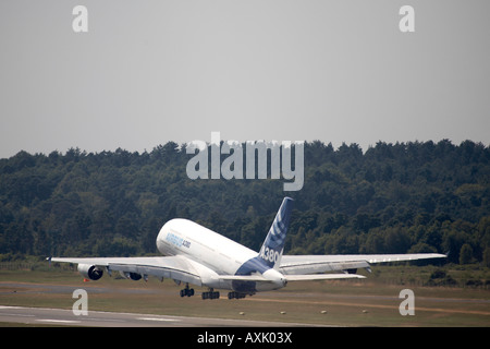 A380 Airbus double decker superjumbo aircraft taking off for its flying display at Farnborough International Airshow - Stock Photo
