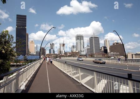 Pedestrian walkway of Victoria Bridge with Central Business District beyond in Brisbane Queensland QLD Australia - Stock Photo