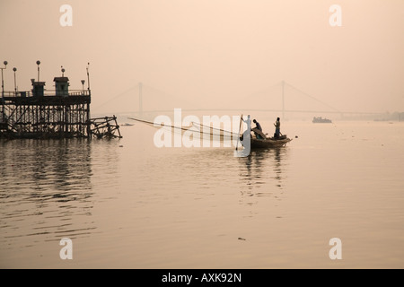 Fishermen are active on the Hooghly River in Kolkata. - Stock Photo