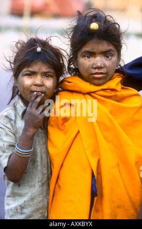 Dirty and impoverished Street children of the untouchable caste begging on the streets of Jaipur Rajasthan India - Stock Photo