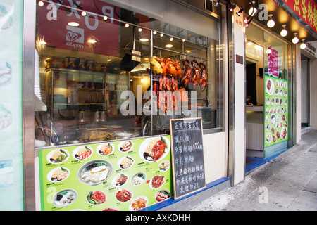 Restaurant shop window with 'Peking Duck' hanging on display in Hong Kong, China - Stock Photo