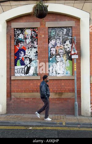 Man walking past Affleck's Palace Manchester - Stock Photo
