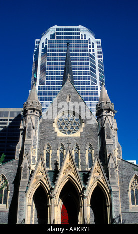 Canada Quebec Montreal the Christ Church Cathedral contrasts with the high rise Promenades de la Cathédrale - Stock Photo