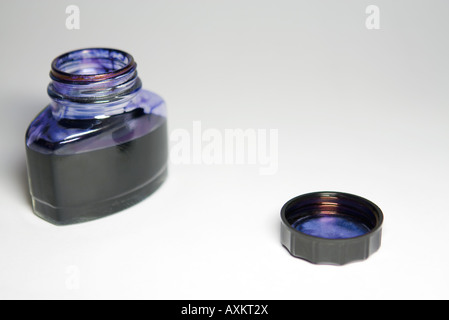 Opened ink bottle, close-up - Stock Photo