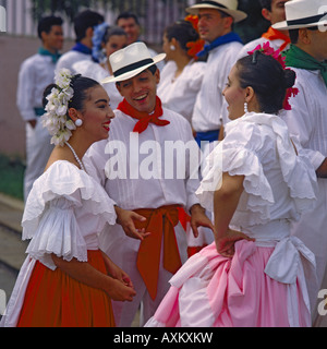 Group of three dancers dressed in traditional colourful costumes in San Juan town Puerto Rico The Caribbean - Stock Photo