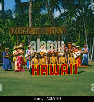 Large group of Hawaiian dancers and singers entertain with guitars ukuleles at The Kodak Hula Show in Waikiki Honolulu - Stock Photo