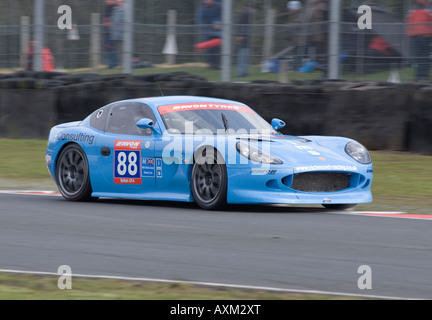 Ginetta G50 GT4 Sports Racing Car in British GT Championship at Oulton Park Motor Race Circuit Cheshire England - Stock Photo