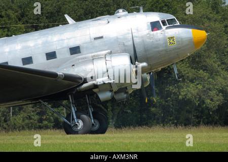 Old airplane Douglas DC-3 Dakota (C-47) during a french vintage air show at La Ferte Alais - Stock Photo