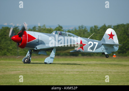 Yak 3U is a old WWII Russian fighter plane, french vintage air show, La Ferte Alais, France - Stock Photo