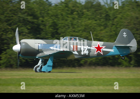 Yak 11 is a old 50's trainer Russian plane converted on this model in one seat , french vintage air show, La Ferte - Stock Photo