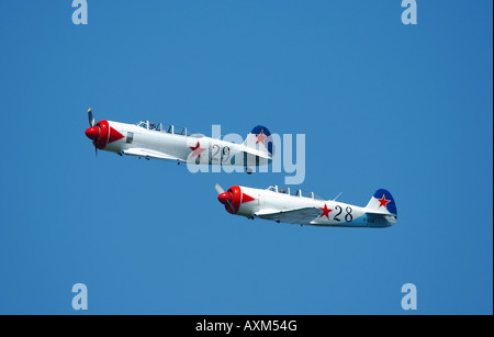 Two Yak 11 an old 50's trainer Russian planes in formation flight, french vintage air show, La Ferte Alais, France - Stock Photo