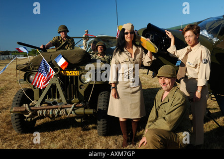 WWII, re enactment of US soldiers with typical Jeep car and Piper J-3 Cub (L-4) plane - Stock Photo