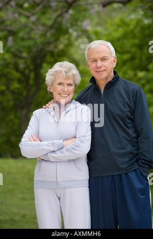 Portrait of senior couple in sweatsuits - Stock Photo