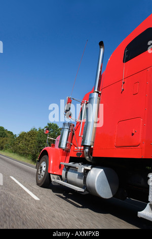 Large red truck on the highway - Stock Photo