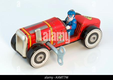 Old clockwork toy racing car. - Stock Photo
