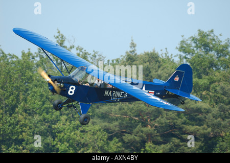 Piper J-3 Cub (L-4) with WWII US Marines colors, french vintage air show at La Ferte Alais, France - Stock Photo