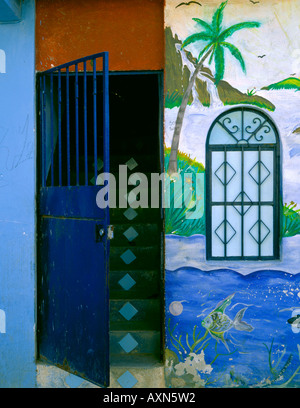 Nayarit, Mexico: Open doorway and painted wall on a side street in the village of Bucerias - Stock Photo