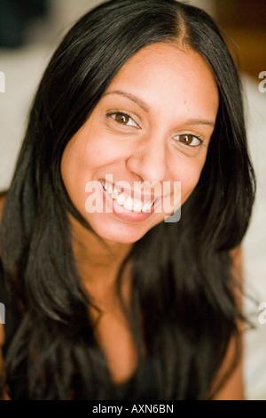 Young Woman with long black hair smiling, Portrait, Close-up, Headshot, Hispanic, Latin, Latina, African-American - Stock Photo
