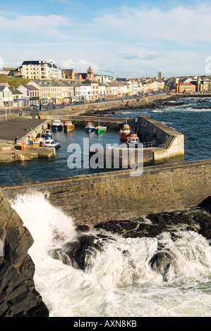 Portstewart fishing boat harbour and main street seafront, County Derry. 3 miles from Coleraine and Portrush, Northern - Stock Photo