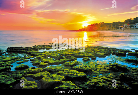 Sundown at the beach of Olhos de Agua, Albufeira, Algarve, Portugal - Stock Photo