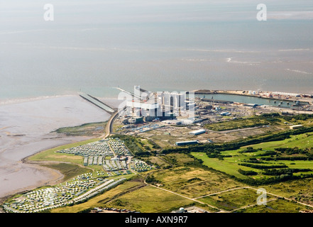 Heysham nuclear power station west of Lancaster with Morecambe Bay behind. Lancashire, England. Aerial view. - Stock Photo