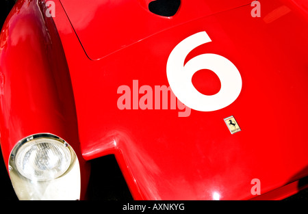 vintage formula one F1 racing car Ferrari number 6 classic power dino headlamp six automobile crimson Italian - Stock Photo