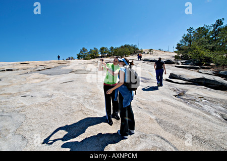 Tourists enjoy the walk to the summit of Stone Mountain Georgia - Stock Photo