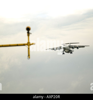 air traffic control signal light cleared for landing approaching airplane plane small jet - Stock Photo