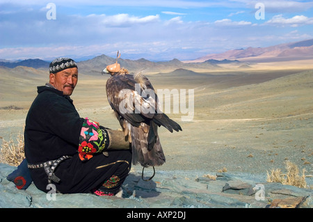 An eagle hunter prepares to demonstrate his eagle for spectators at the annual Eagle Hunting Festival Bayan Olgi, - Stock Photo