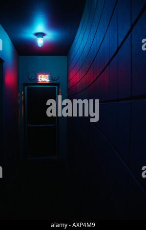 Dark hallway and exit - Stock Photo