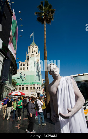 A student of the American Academy of Dramatic Arts displays his skills at make up on Hollywood Boulevard - Stock Photo