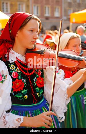 Lowicz folk musicians, Parade during Folklore Days in Olsztyn, Poland - Stock Photo