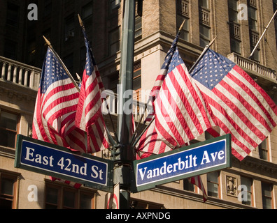 American flags above the street sign at the intersection of Vanderbilt Avenue and East 42nd Street in New York City, - Stock Photo