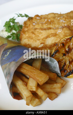Fish and chips served in a newspaper in a restaurant stock for Fish and chips newspaper