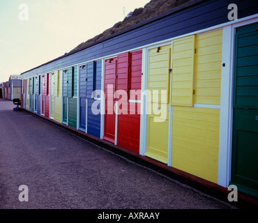 Row of beach huts along the beach promenade at Cromer, Norfolk, UK - Stock Photo