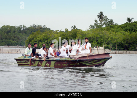 Sri Lanka children : Schoolgirls going to school by river boat, Galle, Sri Lanka, Asia - Stock Photo