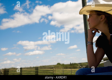 Girl on farm wearing cowboy hat - Stock Photo