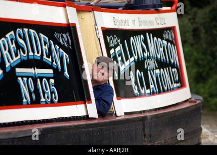 Steam powered narrowboat President on the canal, historic Fellows, Morton & Clayton Ltd. No. 195 - Stock Photo