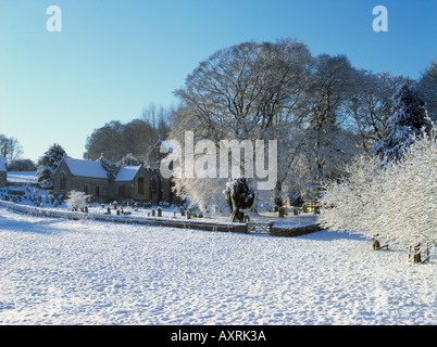Just like a christmas card  the picturesque church in the cotswold village of North Cerney in the churn valley on - Stock Photo