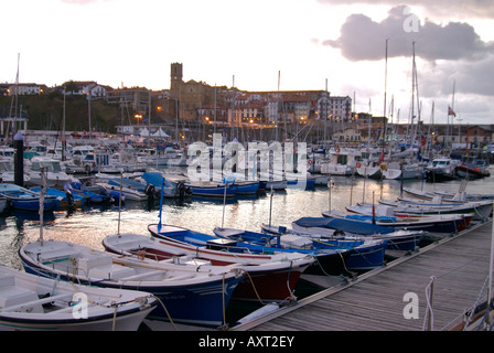 Basque fishing harbour,Guetaria, in early evening, small fishing boats tied up to pontoon Stock Photo