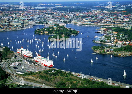 Aerial view of Stockholm with sailboats on Saltsjön and Viking Line passenger ships at Masthamnen docks - Stock Photo