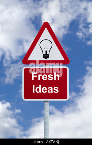 Signpost for Fresh Ideas against a blue cloudy sky business concept image - Stock Photo