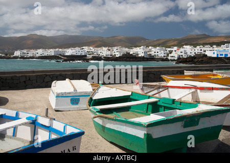 Small fishing boats near Punta Mujeres on the north east coast of Lanzarote in the Canary islands. - Stock Photo