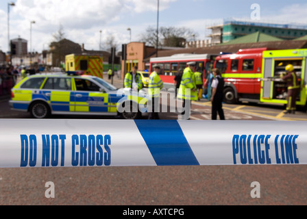 Police officers and cordon sign at the scene of a road traffic accident (RTA), Hounslow, Middlesex, UK. 30th March - Stock Photo
