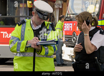 Police officers at the scene at a road traffic accident, Hounslow, Middlesex, UK. 30th March, 2008. - Stock Photo