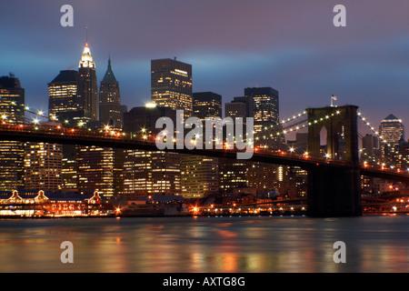 downtown manhattan and brooklyn bridge lights at night, new york city, new york, usa - Stock Photo